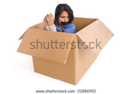 A young woman tied up inside the box is thinking how to escape. - stock photo