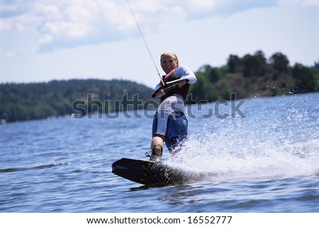 A young woman water skiing - stock photo