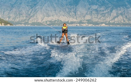 a young woman water skiing on a sea