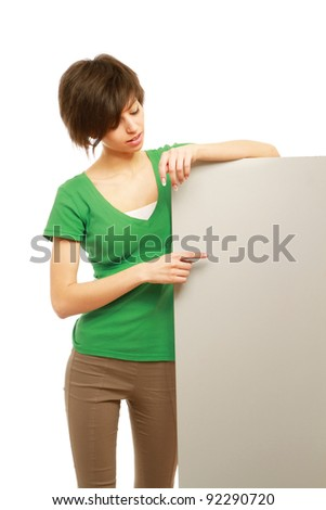 A young woman with a blank isolated on white background - stock photo