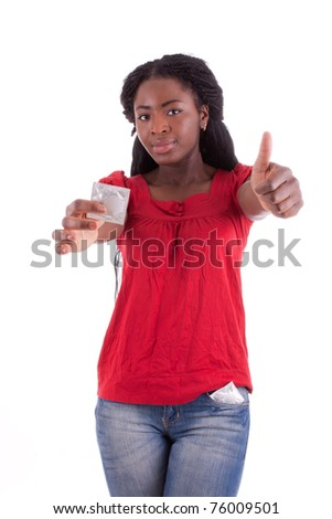 A young woman with a condom in her hand - stock photo