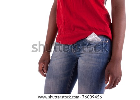 A young woman with a condom in her trouser pocket - stock photo