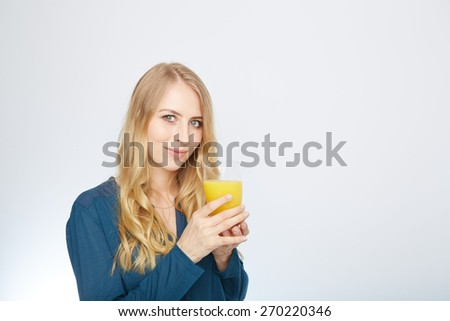 a young woman with a glass of orange juice. isolated on white. - stock photo