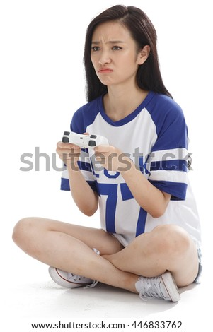 A young woman with a remote control