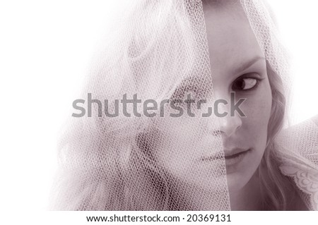 A young woman with a translucent lace veil. - stock photo