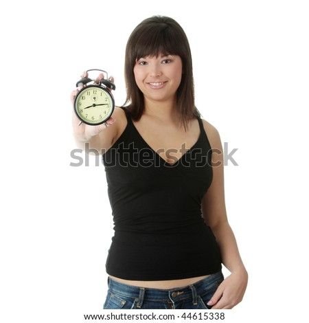 A young woman with alarm clock isolated - stock photo
