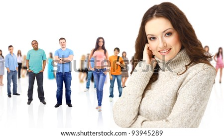 a young woman with big group of the young smiling students. Over white background - stock photo