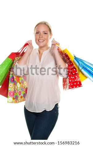 a young woman with colorful shopping bags while shopping. pleased with the bargain. - stock photo