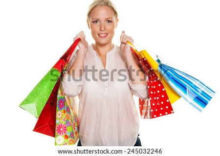 a young woman with colorful shopping bags while shopping. pleased with the deal. - stock photo