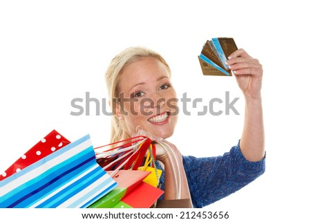 a young woman with colorful shopping bags while shopping. using credit cards for cashless payment - stock photo