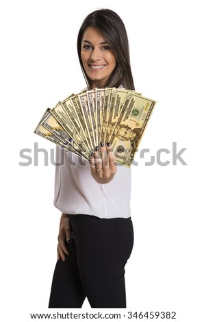 A young woman with dollar money in her hands, isolated on white background