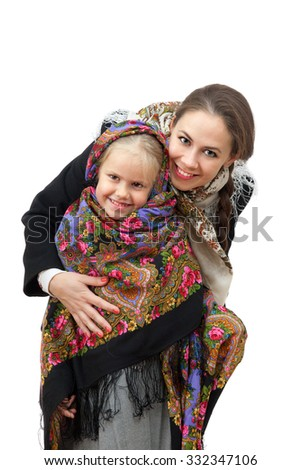 A young woman with little girl in Russian kerchiefs