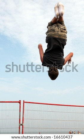 A youth trampolining on the beach at Great Yarmouth, England - stock photo