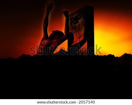 A zombie emerging from the ground with a atmospheric background. - stock photo