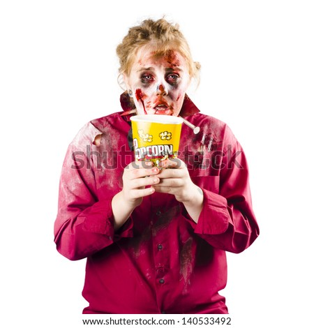 A zombie woman with a bucket of popcorn, scary movie concept - stock photo
