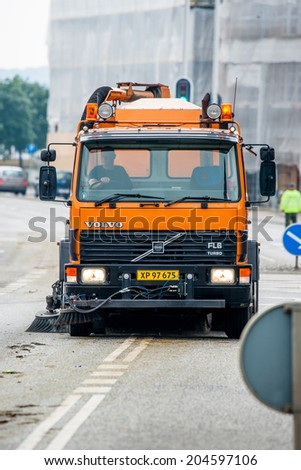 AABENRAA, DENMARK - JULY 6 - 2014: Sweeper cleaning the streets at the annual tilting festival in Aabenraa - stock photo