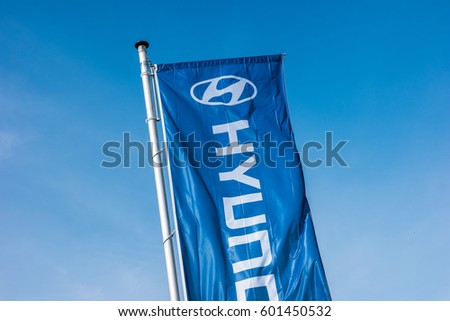 AACHEN, GERMANY MARCH, 2017: Hyundai logo on a flag. Hyundai Motor Company is a South Korean multinational automotive manufacturer founded at 1967.