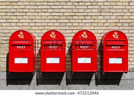 Aarhus, Denmark - August 1, 2016: Red danish letterboxes on a wall
