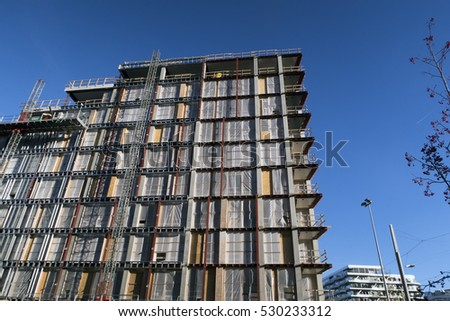 AARHUS, DENMARK -  NOVEMBER 24, 2016:  New modern apartment building site with windows and balconies all over. The new building at Aarhus Harbour is not yet finished,  November 24, 2016