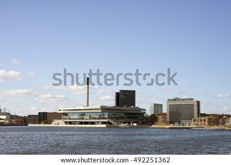 AARHUS, DENMARK - SEPTEMBER 18, 2016: Aarhus harbor skyline - view from Aarhus new harbor area. Dokk1 in front of skyline. September 18, 2016