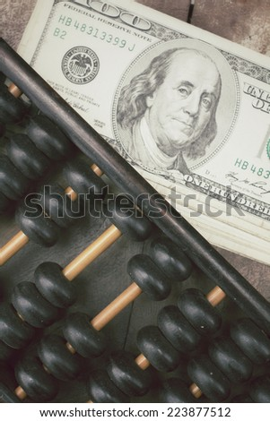 Abacus and dollars