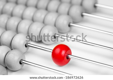 Abacus red bead closeup. Leadership concept. - stock photo