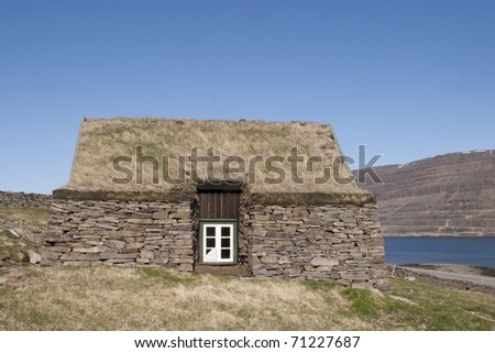 Abandon Antique Turf house. - stock photo