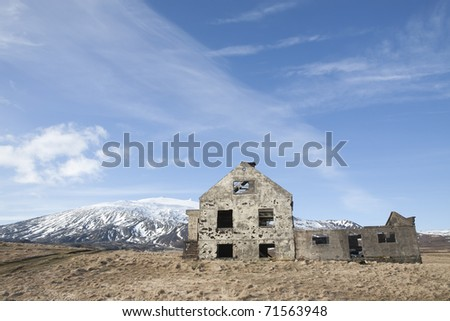 Abandon house under the glacier - stock photo