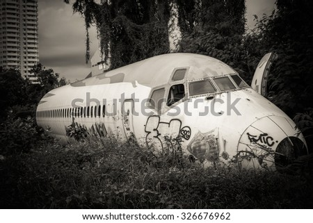 Abandoned Airplane,old crashed plane with,plane wreck tourist attraction,Old plane wreck,out focus - stock photo