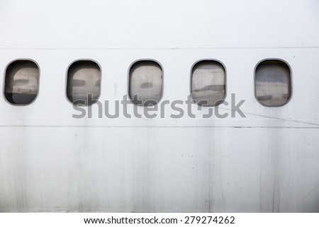 Abandoned airplane window - stock photo