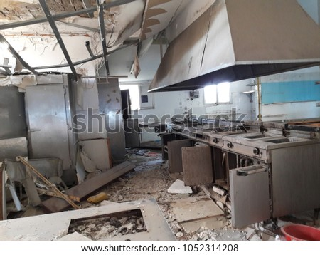 Abandoned and ruined kitchen place of a closed restaurant