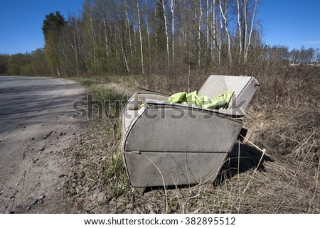 abandoned armchair - stock photo