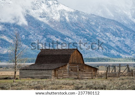 Abandoned barn at Mormon Row in Grand Teton National Park during autumn - stock photo