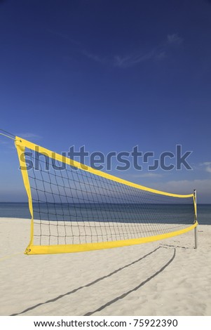 Abandoned beach volleyball net - stock photo