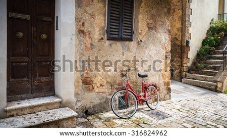 Abandoned bike on the Italian street in the old Tuscany - stock photo