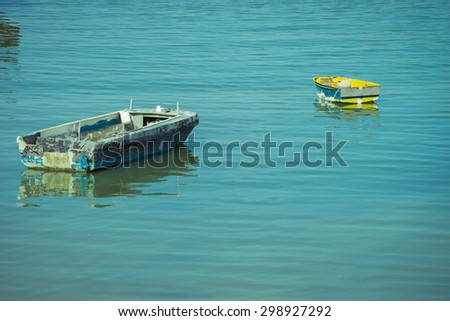 Abandoned boats laying in Portsmouth harbour. - stock photo