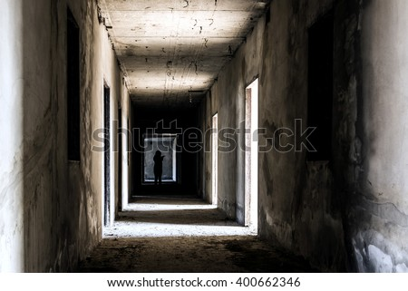 Abandoned building ghost living place with scary zombie woman inside, darkness horror and halloween background concept
