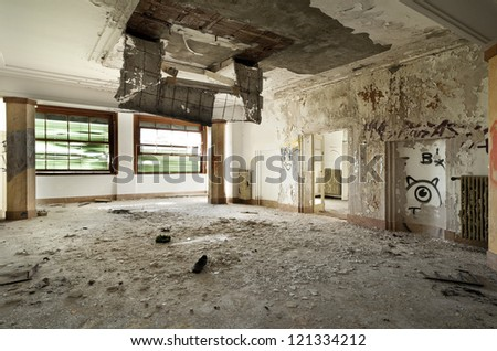 abandoned building, large room, debris on the floor - stock photo
