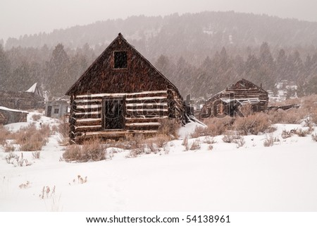 Abandoned buildings in a once thriving mining town in Montana during a snowstorm - stock photo