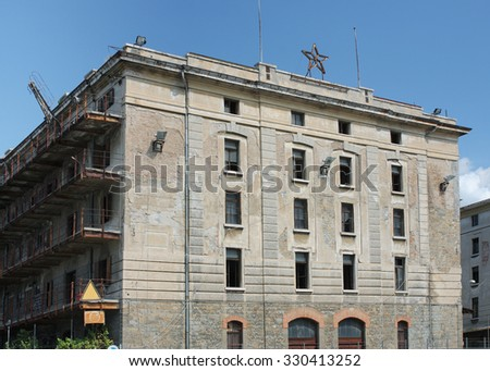Abandoned buildings in old harbour in Trieste, Italy - stock photo