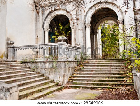 Abandoned buildings, stairways and arches - stock photo