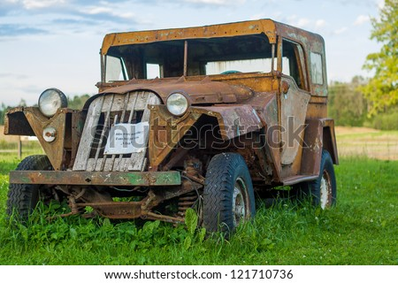 Abandoned car wreck by unknown mark found in World War 2 battlefield - stock photo