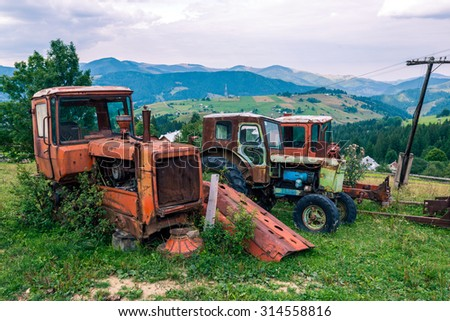 Abandoned cars in the Carpathian Mountains of Transylvania in Romania in the summer