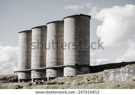 Abandoned cement silos, Maria Island, Tasmania, Australia.  Maria island was leased in 1884 to Italian merchant Diego Bernacchi who built the cement works - wound up in 1929 -now an imposing monument  - stock photo