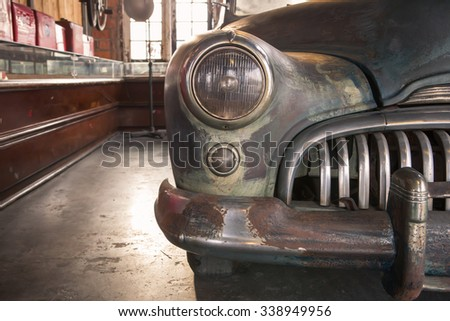 abandoned  classic car - stock photo