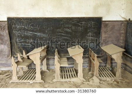 abandoned desks in a old school - stock photo