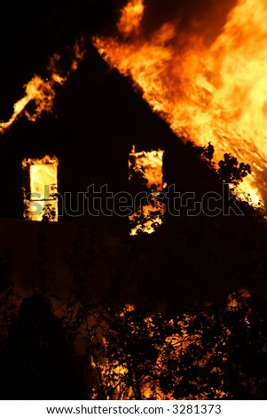 Abandoned Detroit house on fire during the night - stock photo