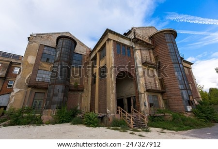Abandoned factory against blue sky - stock photo