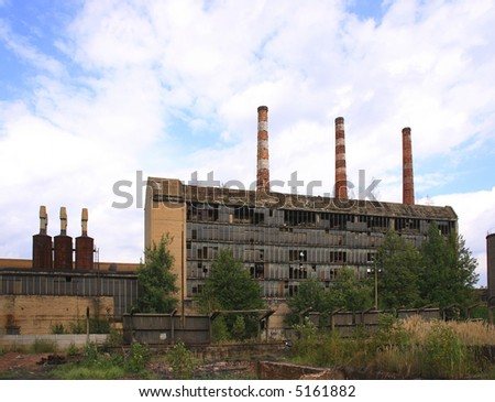 Abandoned factory in Poland with blue sky and white clouds