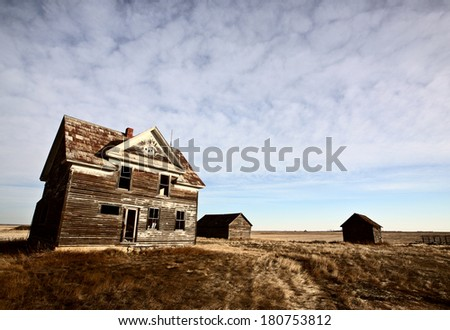 Abandoned farm house on the Prairie - stock photo